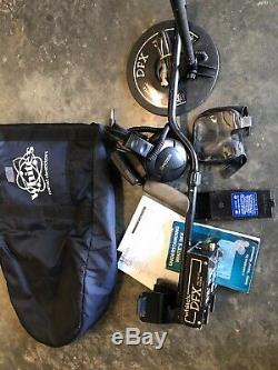 White's DFX metal detector, standard coil, and Koss headphones. Used and works